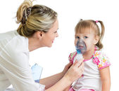 Doctor holding inhaler mask for kid breathing, hospital — Stock Photo