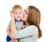 Loving mother holding baby boy isolated on white — Stock Photo