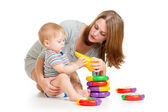 Baby boy and mother playing together with construction set toy — Stock Photo