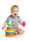 Funny baby boy playing with colorful toy isolated on white — Stock Photo