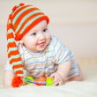 Stock Photo: Cute crawling baby boy indoors