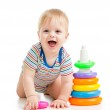 Happy baby boy playing with colorful toy isolated on white — Stock Photo #16040743