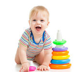 Happy baby boy playing with colorful toy isolated on white — Stock Photo