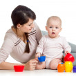 Kid girl and mother playing together with cup toys — Stock Photo