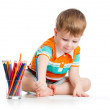 Funny baby boy drawing with color pencils — Stock Photo #18473215