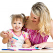 Mother and her child fun games with color pencils — Stock Photo #18473281