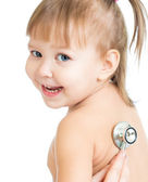 Pediatric doctor examining little baby girl with stethoscope iso — Stock Photo