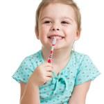 Cute kid girl brushing teeth isolated on white background — Stock Photo