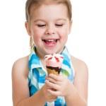 Joyful child girl eating ice cream in studio isolated — Stock Photo #19044269