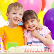 Adorable children celebrating birthday party - Stock Photo