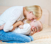 Mother playing with baby boy indoors — Stock Photo