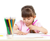 Cute girl drawing with colourful pencils — Stock Photo