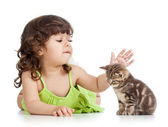 Funny happy child playing with cat kitten — Стоковое фото