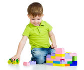 Kid boy playing with construction set over white background — Stock Photo