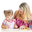 Mother and her child fun games with color pencils — Stock Photo #19109115