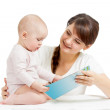 Happy mother reading a book to child — Stock Photo