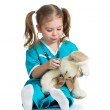 Adorable child with clothes of doctor examining hare toy over wh — Stock Photo #19109165
