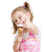 Happy kid girl eating ice cream and showing thumb up — Stock Photo