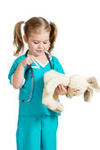Adorable child with clothes of doctor with hare toy over white — Stock Photo