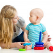 Stock Photo: Baby boy and mother playing together