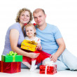 Parents and kid girl with gifts isolated on white background — Stock Photo