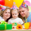 Kid girl with parents on birthday party — Stock Photo