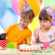 Adorable children celebrating birthday party and opening gift bo — Stock Photo