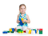 Little cheerful child with construction set over white backgroun — Stock Photo