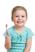 Cute kid girl brushing teeth isolated on white background — Stock Photo