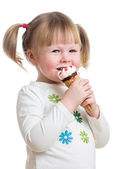Cute little girl eating ice cream in studio isolated — Stock Photo