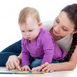 Mother reading a book her baby girl — Stock Photo #19618405