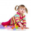 Kid girl playing with toys. Isolated on white background — Stock Photo
