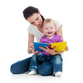 Happy mother reading a book to baby girl — Stock Photo