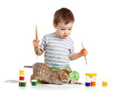 Kid drawing paints with cat — Stock Photo