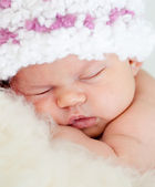 Sleeping adorable baby girl weared cap close-up — Stock Photo