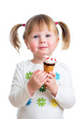 Cute kid girl eating ice cream in studio isolated — Stock Photo