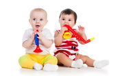 Funny babies girls with musical toys. Isolated on white backgro — Stock Photo