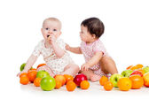 Funny kids babies eating healthy food fruits isolated on white b — Stock Photo