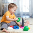 Child boy playing with toy at home. — Stock Photo