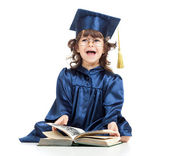 Emotional funny child in academician clothes with book — Stock Photo