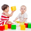 Two babies girls playing together with color toys — Stock Photo