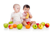Funny children babies with healthy food fruits isolated on white — Stock Photo