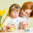 Mother and daughter kid painting easter eggs — Stock Photo