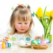 Cute smiling baby girl painting Easter eggs isolated on white ba — Stock Photo
