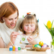 Mother and daughter kid painting easter eggs isolated — Stock Photo #20944777