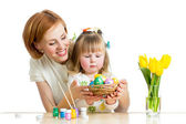 mother and baby kid painting easter eggs — Stock Photo