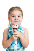 Joyful child girl eating ice cream in studio isolated — Stock Photo