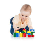 Little child playing with building blocks — Stock Photo