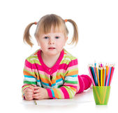 Kid girl drawing with colourful pencils — Stock Photo