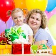 Little girl and mother celebrate birthday holiday — Stock Photo #21090179
